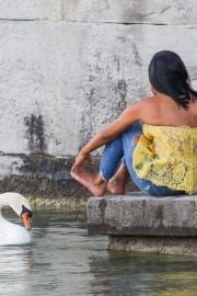Christina Milian comes head to head with a swan in Zurich