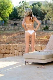 Caprice Bourret Sunbathing in Bikini at a Pool Photos