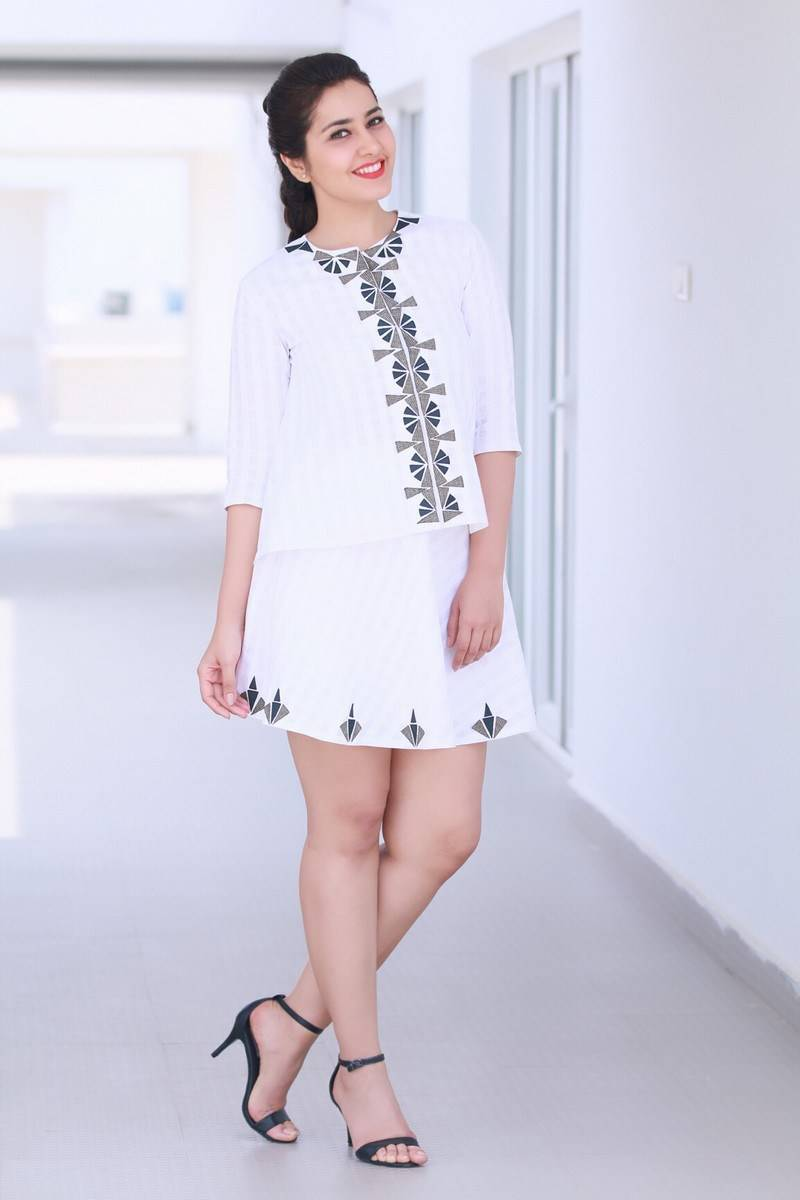 Rashi Khanna Hot Photoshoot in White Mini Skirt Pics
