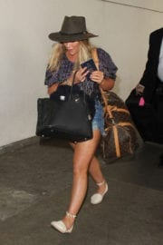 Hilary Duff Stills Images in Jeans Shorts at LAX Airport in Los Angeles