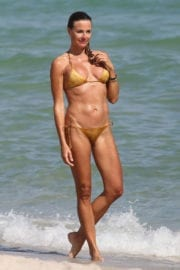 Kelly Killoren Bensimon in Gold Bikini in Miami Beach Photos