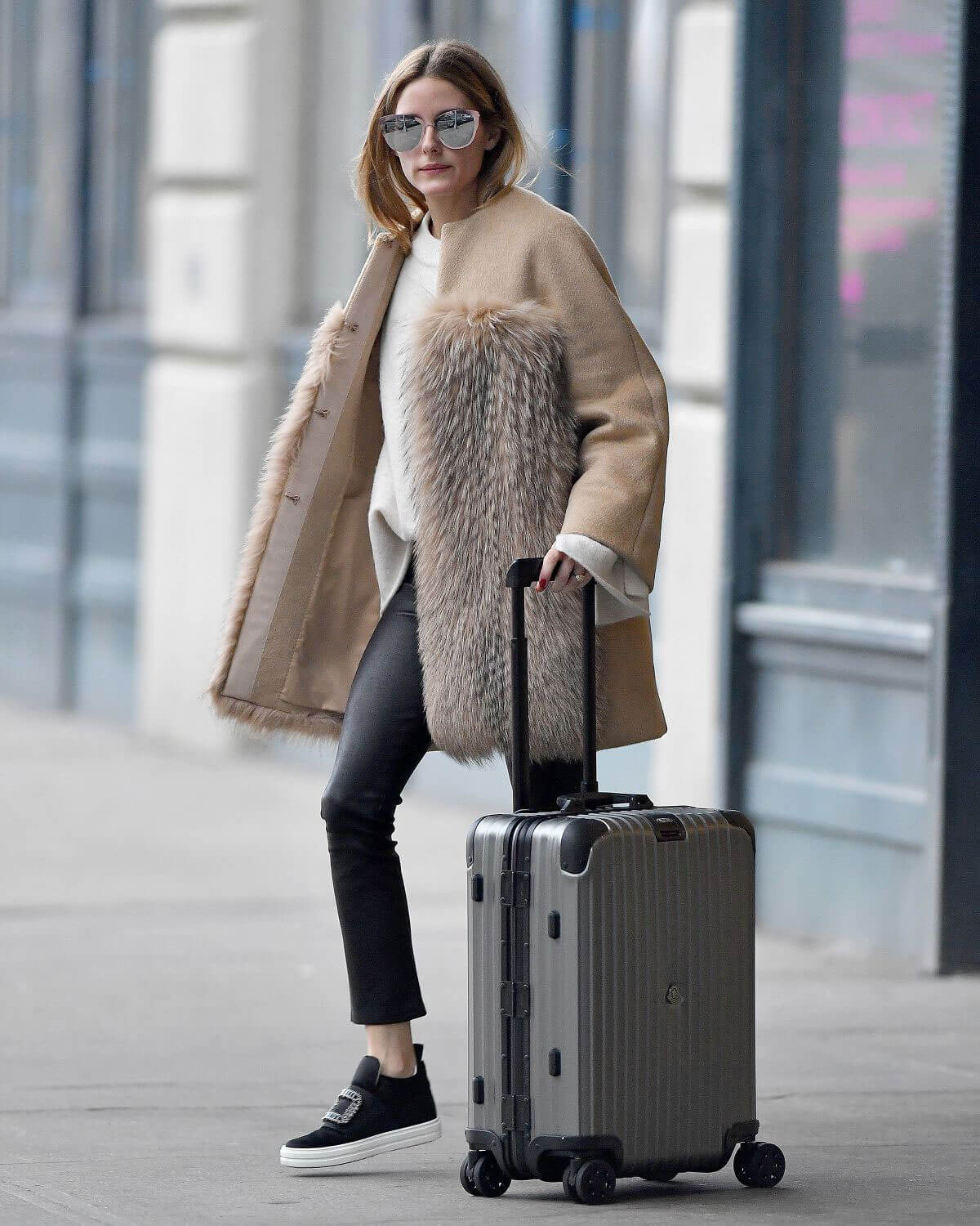 Olivia Palermo Leaves Her Apartment In New York