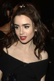 Lily Collins Stills Leaves Charles Finch and Chanel Pre Oscar Awards Dinner in Beverly Hills