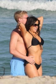 Claudia Romani and Christopher Johns Stills at a Beach in Miami