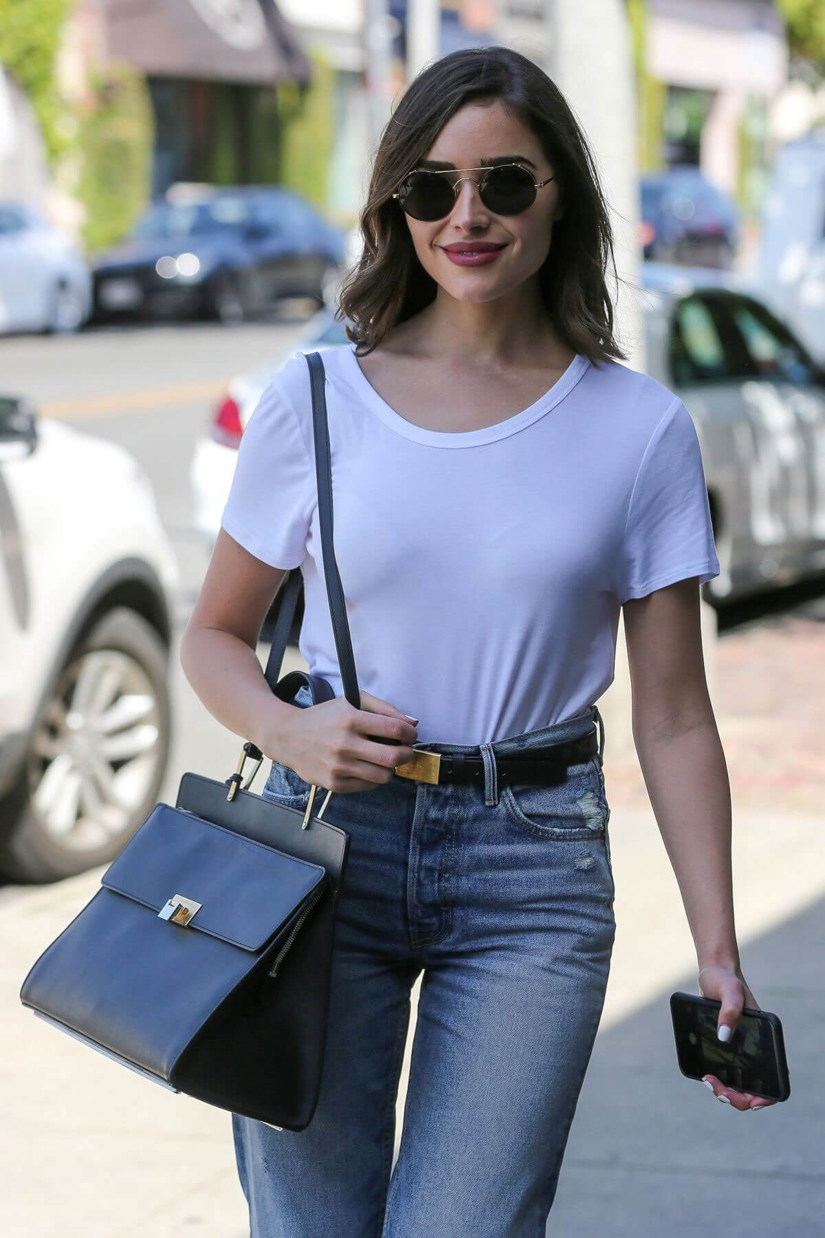 Olivia Culpo Stills in Jeans Out Shopping in West Hollywood