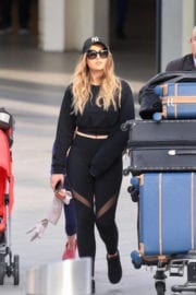 Perrie Edwards Stills at Heathrow Airport in London