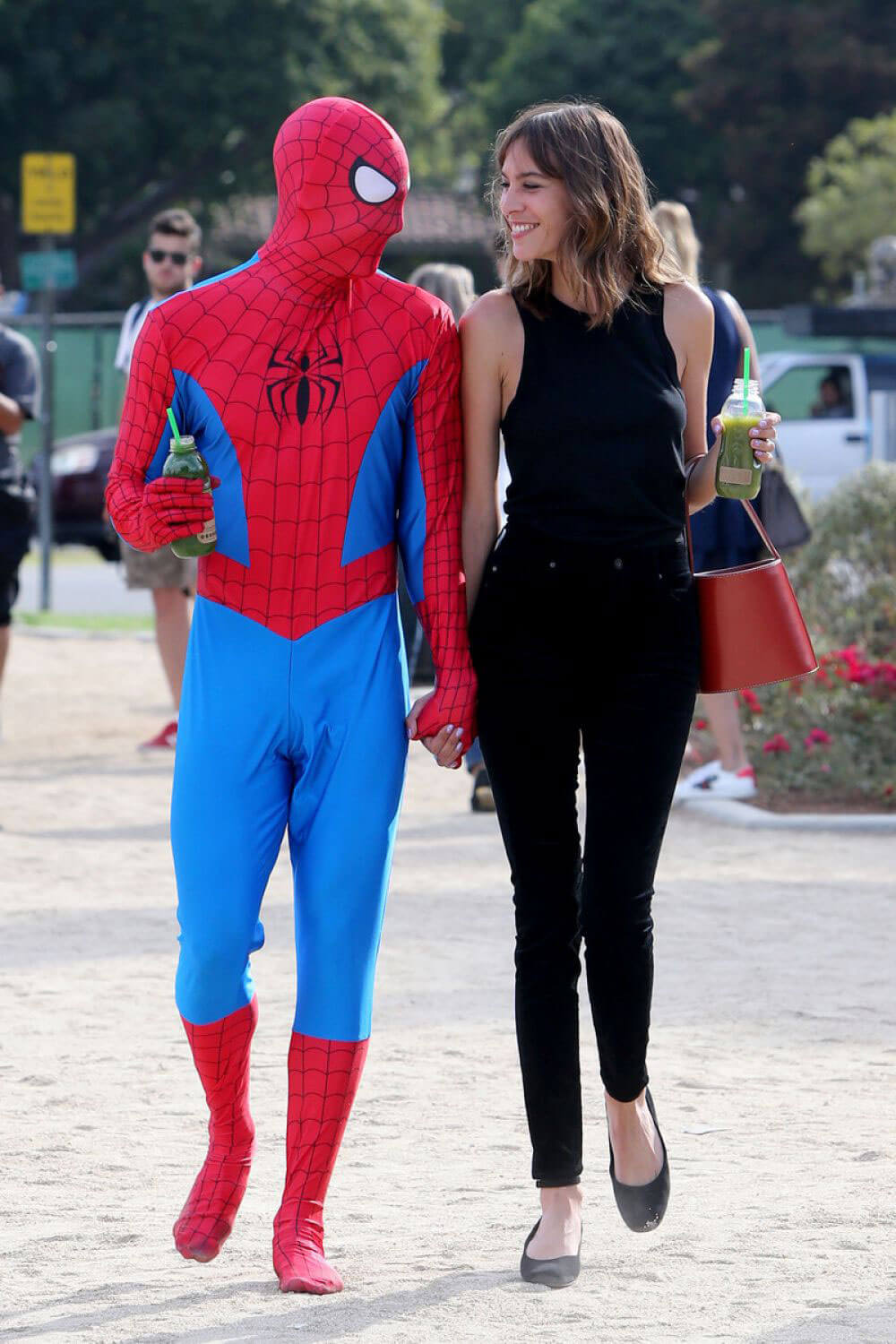 Alexa Chung with Spider-man in a Red '65 Ragtop Mustang Out Filming in Beverly Hills