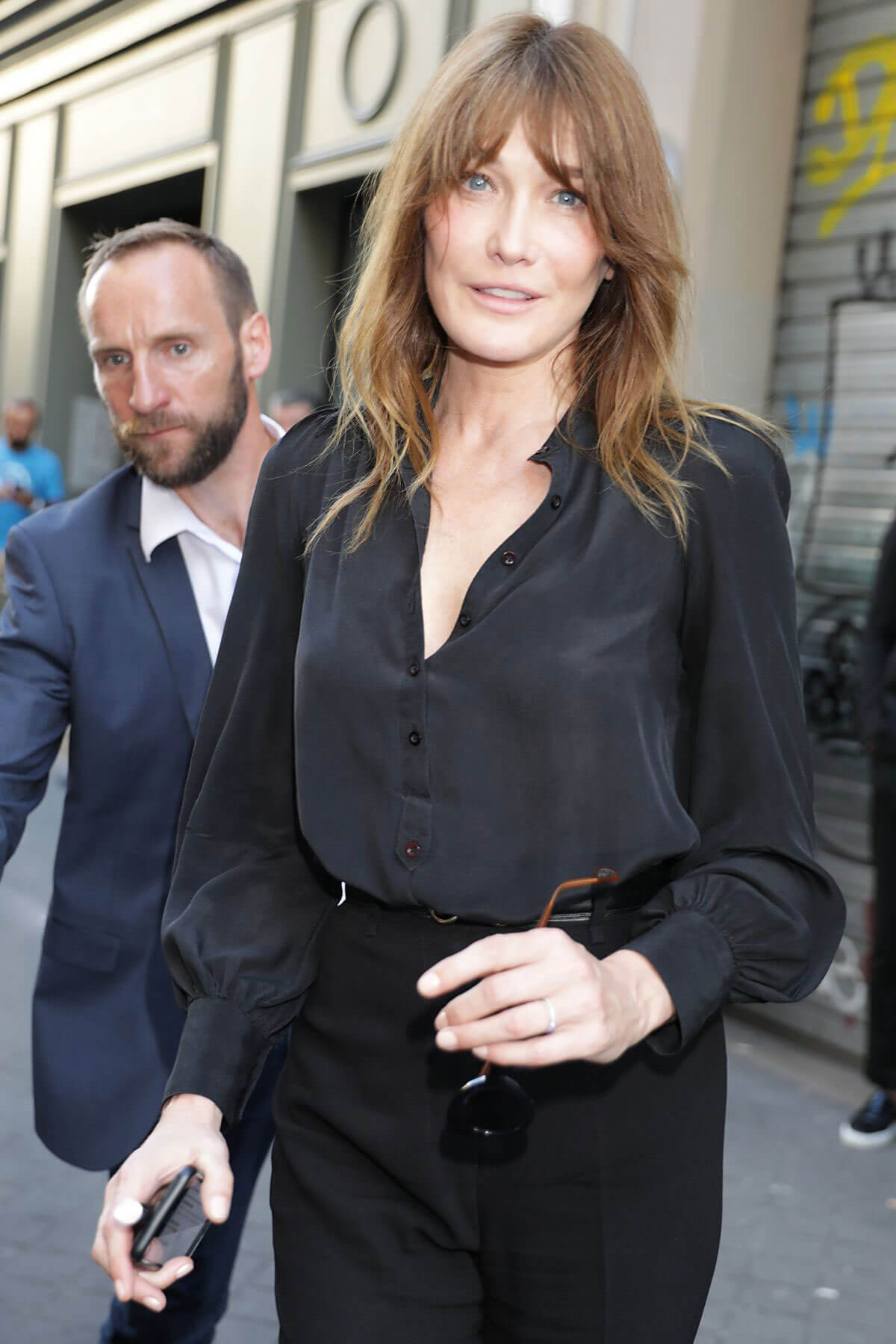 Carla Bruni Leaves Azzedine Alaia Fashion Show at Haute Couture Paris Fashion Week