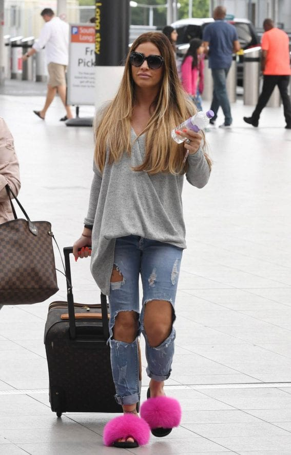 Katie Price Stills at Gatwick Airport in London
