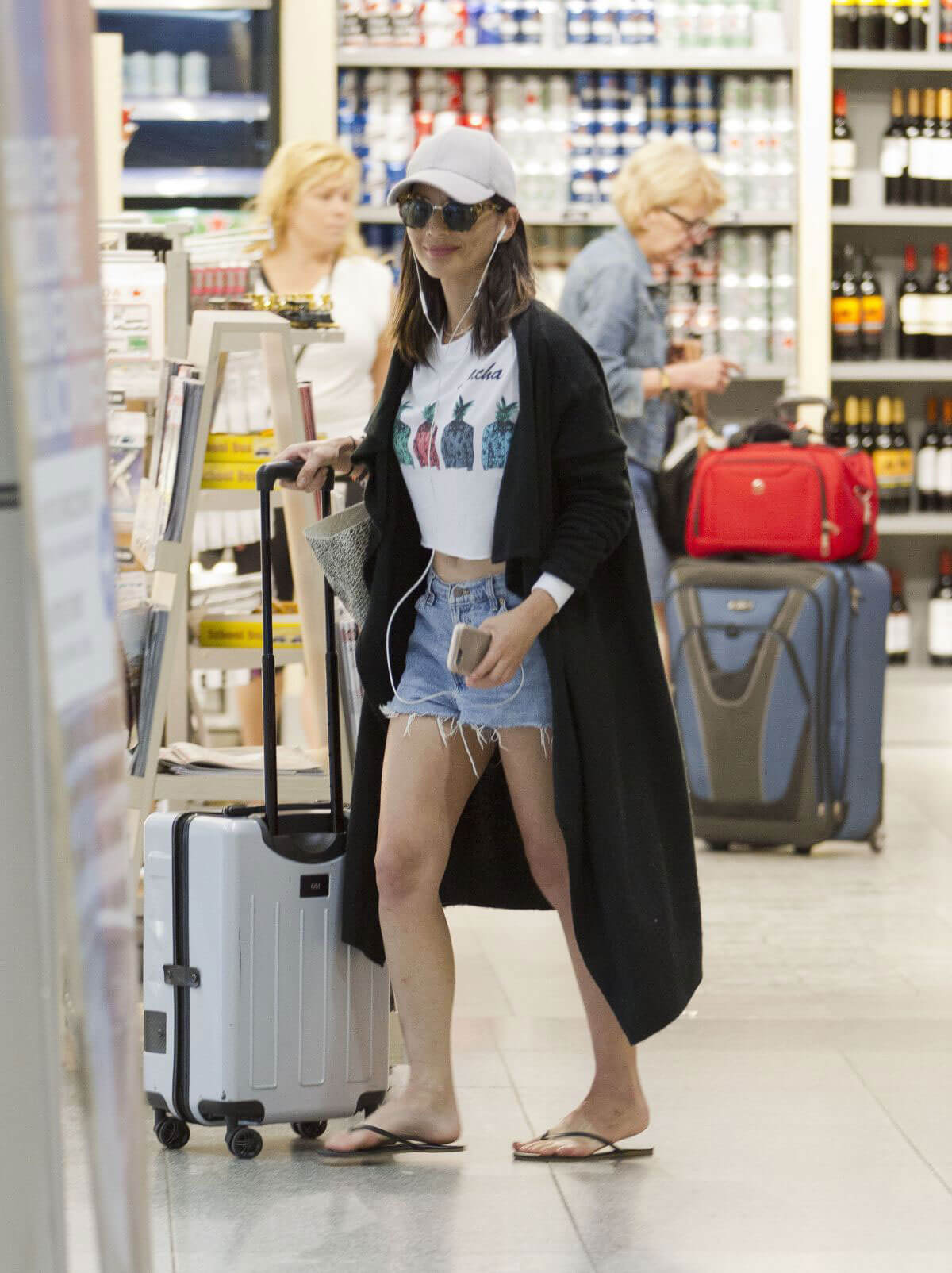 Olivia Munn Stills at Airport in Montreal