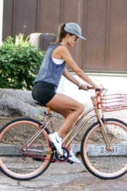 Alessandra Ambrosio rides her cycling during workout in Los Angeles