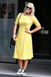 Amelia Lily wears yellow dress arrives at her office in London