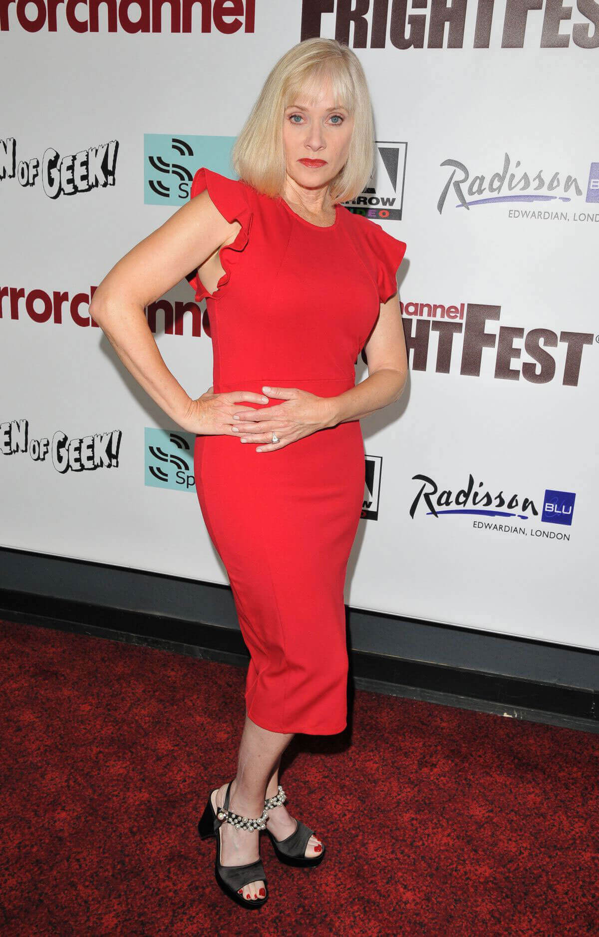 "Barbara Crampton wears Red Dress in ""Replace"" Film Premiere in London"