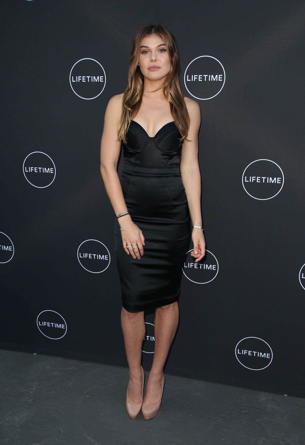 Cambrie Schroder wears black dress at Growing Up Supermodel Premiere in Studio City