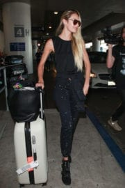 Candice Swanepoel displays toned figure at Los Angeles International Airport