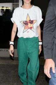 Cara Delevingne wears white top and green bottom at LAX Airport in Los Angeles