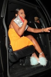 Christina Milian wears yellow dress at Poppy Club in Hollywood