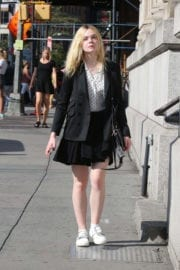 Elle Fanning wears short skirts shows off legs out and about in New York