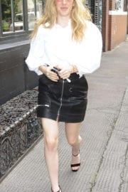 Ellie Goulding shows hot legs in short skirt Out in London