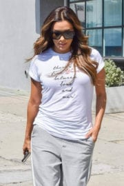 Eva Longoria wears white top with grey fitted bottom out in Los Angeles
