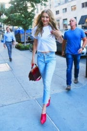 Gigi Hadid wears white top and light blue jeans out in New York
