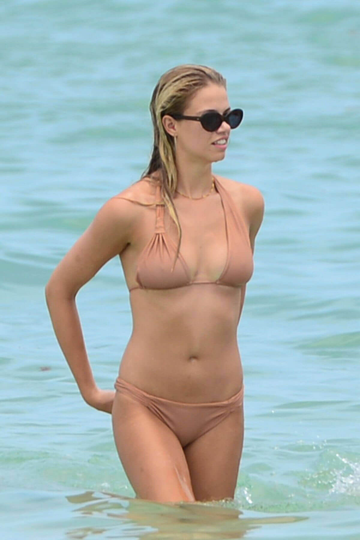 Hailey Clauson wearing skinny color Bikini on the Beach in Miami