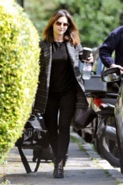 Jenna Coleman wears black top and jeans out and about in London