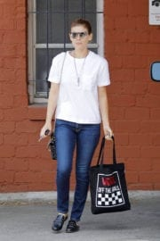 Kate Mara wears white top and blue jeans Out and About in Los Angeles