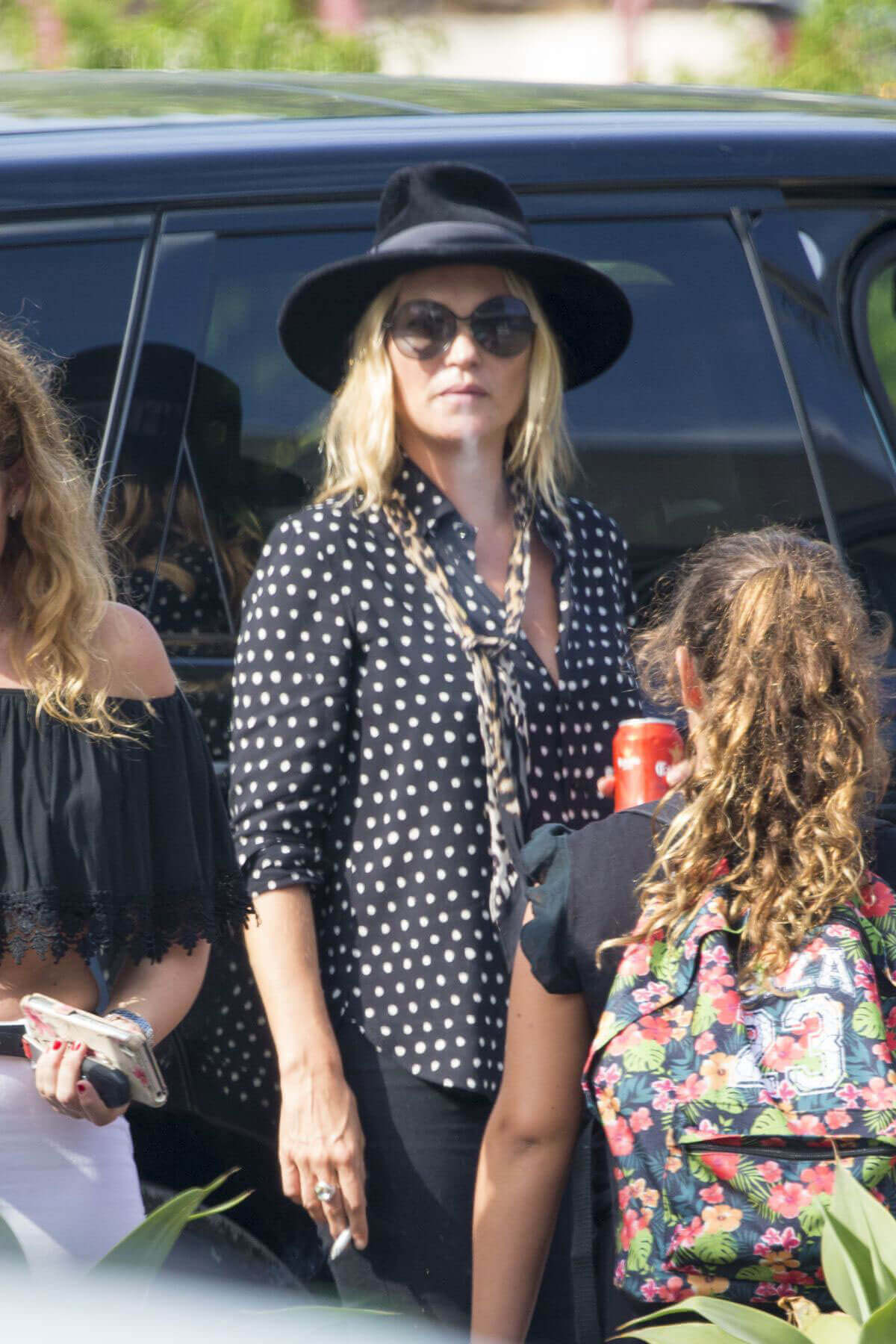 Kate Moss Drinks Beer & Smoking Waiting for Her Driver at Airport in Ibiza
