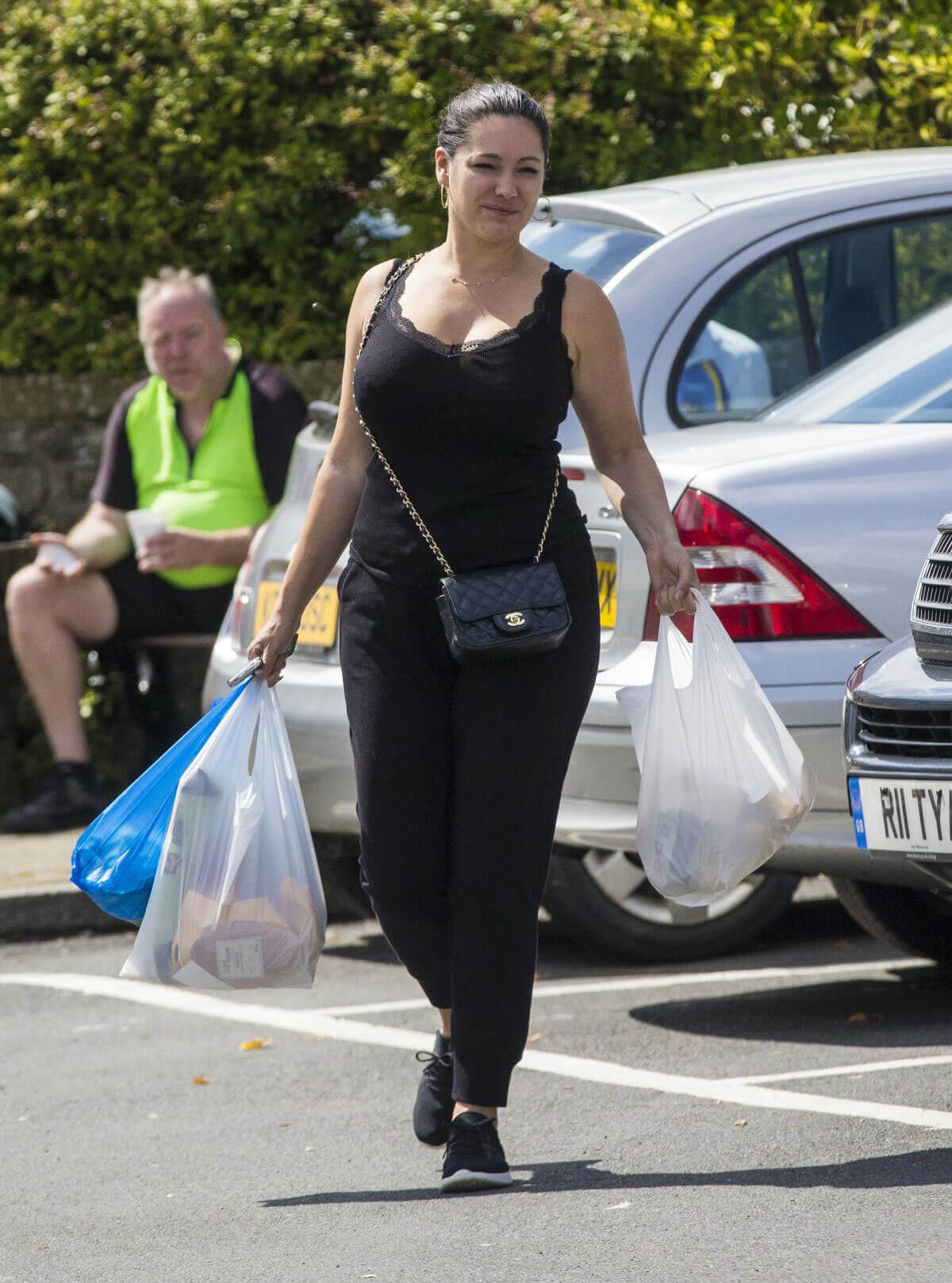 Kelly Brook shopping in tight jeans and black low vest top in Kent