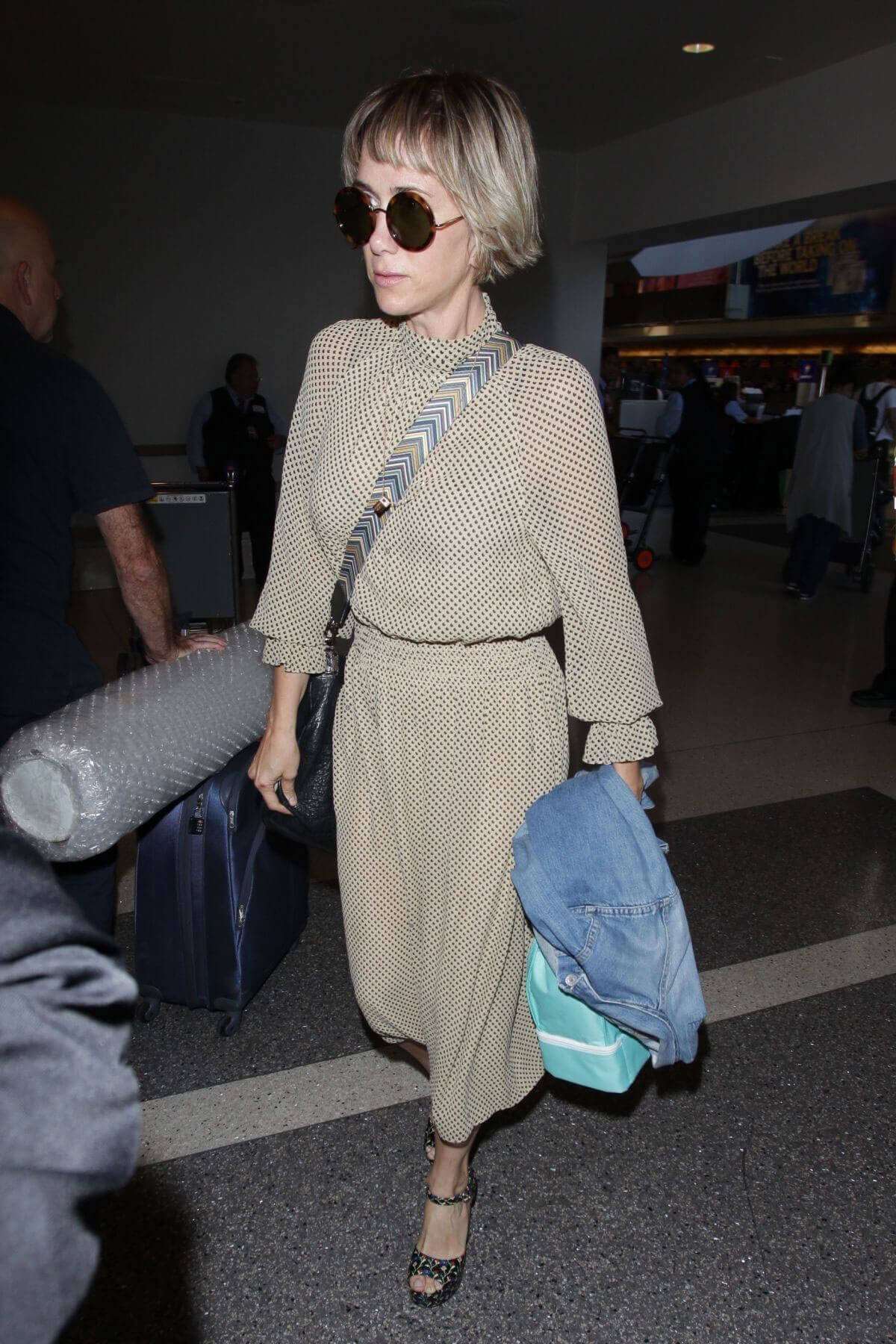 Kristen Wiig Stills at Los Angeles International Airport