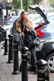 Lauren Pope wears black top and grey jeans Stills Out in Essex