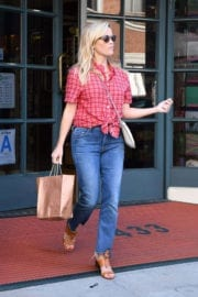 Reese Witherspoon wears stylish red checked top at a pharmacy in Los Angeles