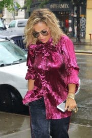 Rita Ora Stills wearing Purple Shirt and Black Bottom Out and About in New York