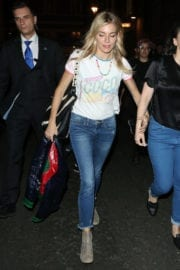 Sienna Miller wears white tshirt and blue jeans Out in London