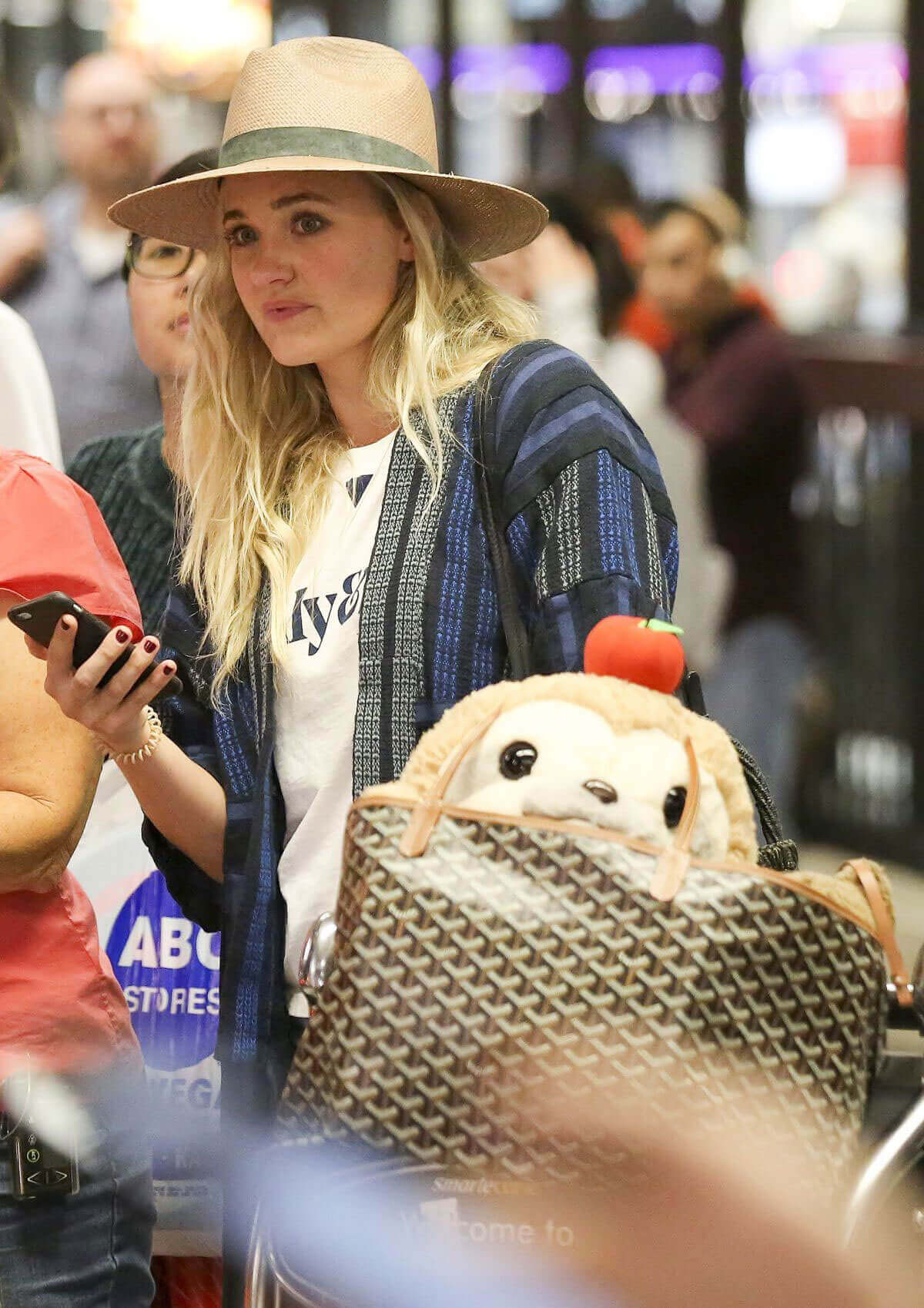 AJ Michalka wears Hat Stills at Los Angeles International Airport