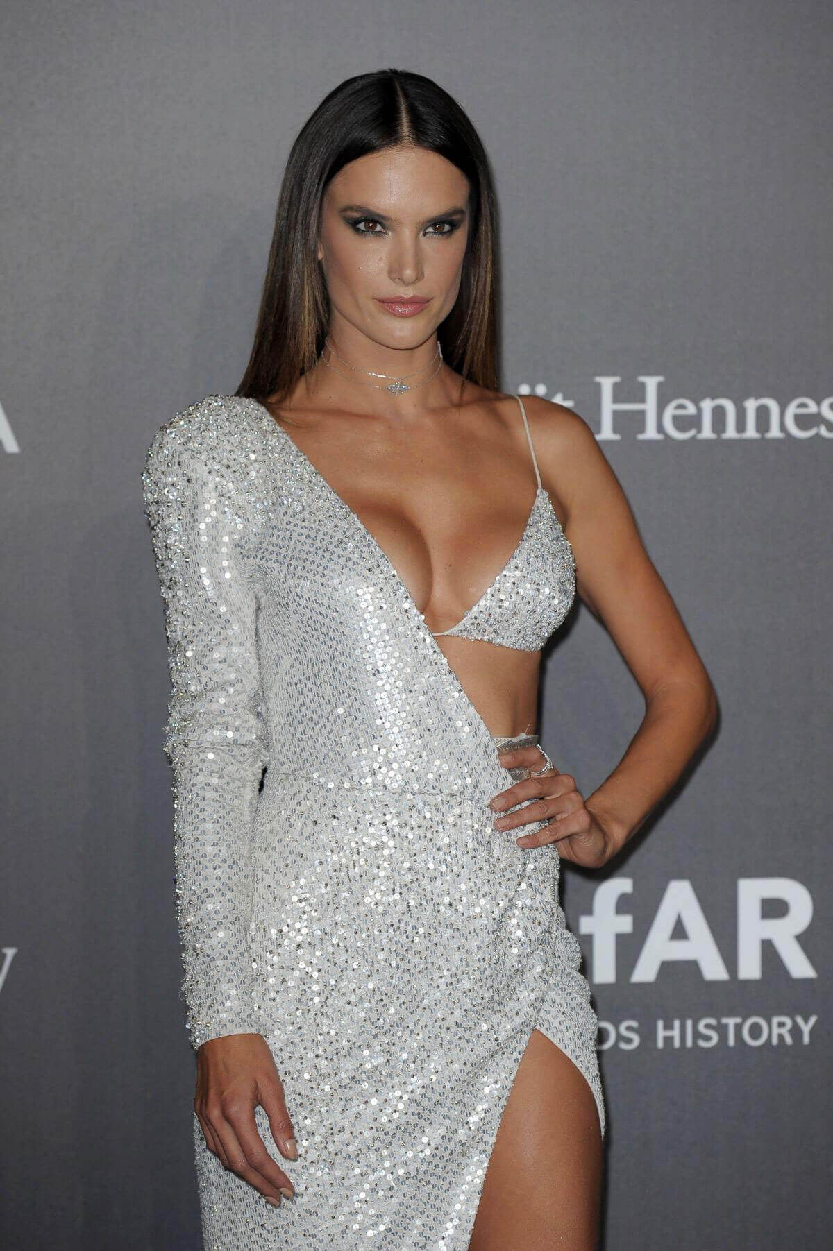 Alessandra Ambrosio shows off major cleavage at Amfar Gala in Milan