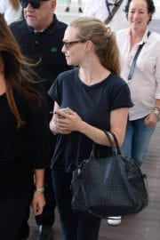 Amanda Seyfried wears black top & jeans arrives at airport in Venice