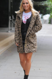 Amelia Lily flashes her legs in black dress out and about in London