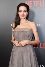 Angelina Jolie shows off her back tattoos at 'First They Killed My Father' premiere in NYC