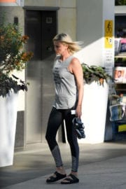 Charlize Theron wears sports sleeveless top leaves soul cycle in Los Angeles