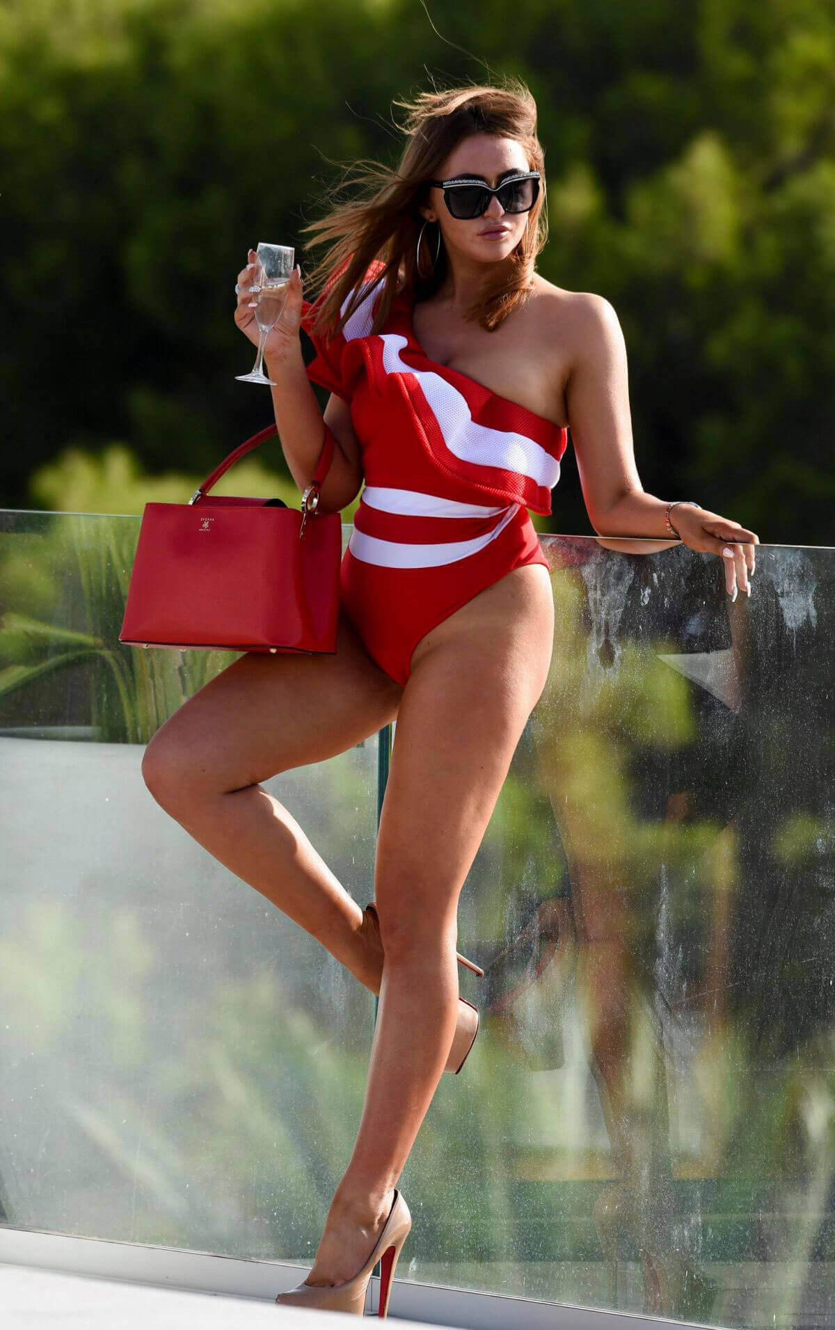Charlotte Dawson flashes her bum in Swimsuit on The Set of A Photoshoot in Tenerife