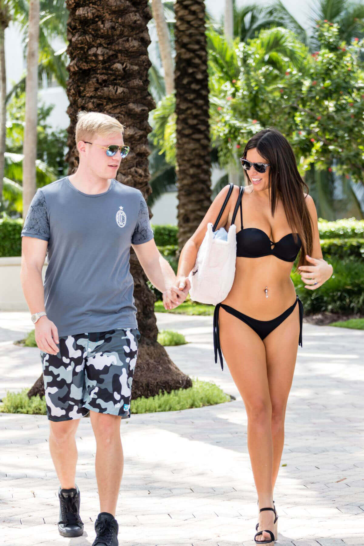 Christopher Johns with Claudia Romani wears Bikini Stills at South Beach in Miami