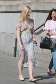 Elle Fanning shows off shiny legs out and about in New York