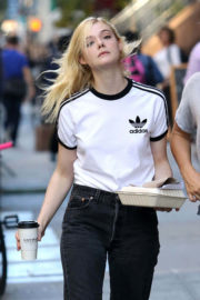 Elle Fanning wears Adidas T-Shirt & Black Jeans on the Set of 'Woody Allen' Movie in New York