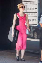 Elle Fanning wears pink pinafore dress during shopping at barney's in New York