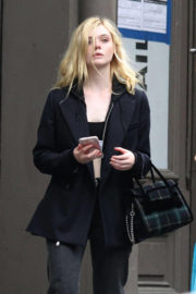 Elle Fanning wears Sports Bra Out and About in New York