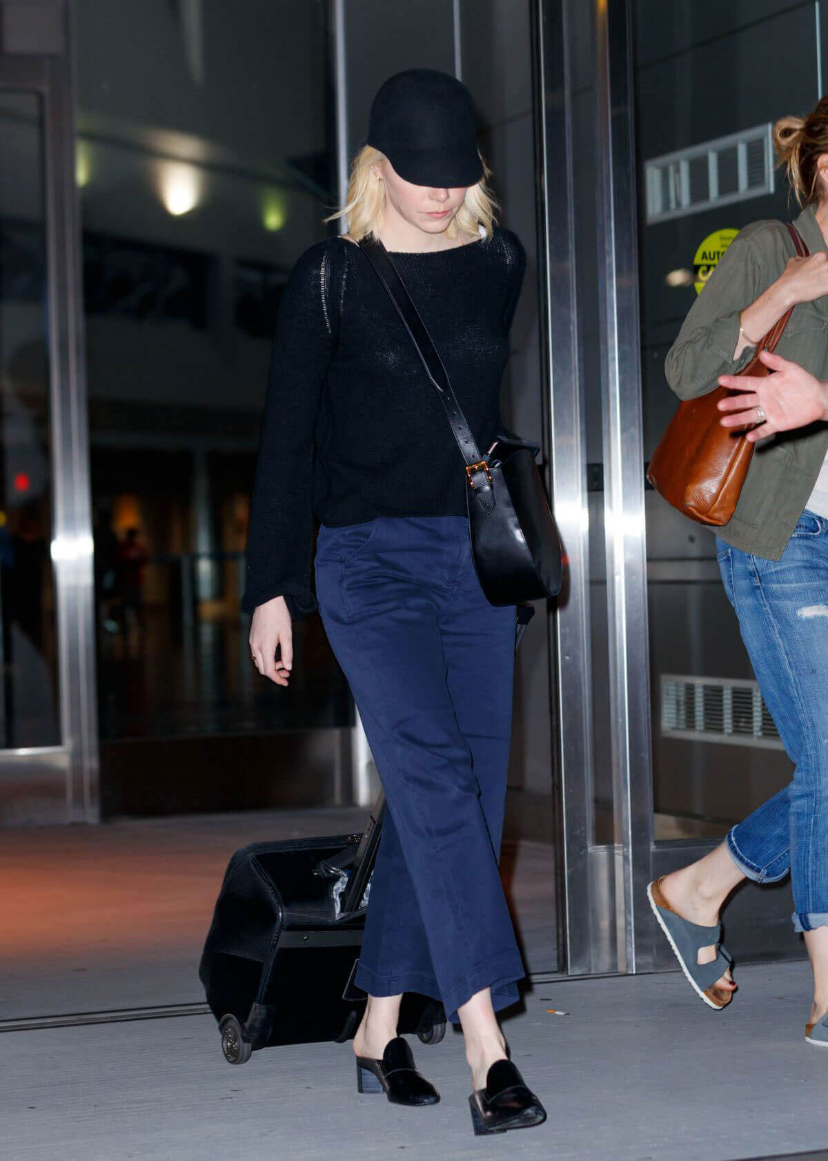 Emma Stone wears Black Top & Jeans at JFK Airport in New York