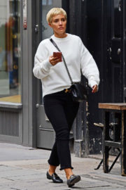 Frankie Bridge wears Slogan Sweater Out and About in London