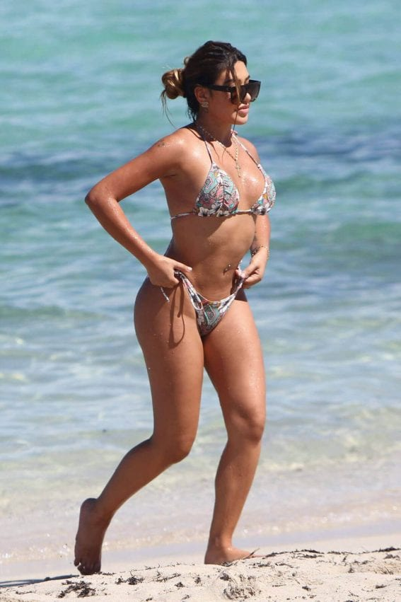 Gaby Suarez Stills in Bikini at a Beach in Miami